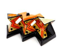 A Lorna Bailey pottery five piece condiment set, of waisted triangular form, on a five point base,