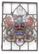 A stained glass window panel, bearing the Coat of Arms of The City of Cambridge, 86cm high, 62cm
