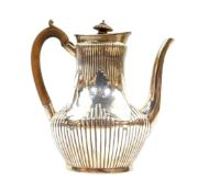 A Victorian silver fluted coffee pot, crest engraved with a demi lion rampant and motto 'Fide'.,