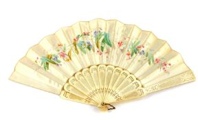 A Continental late 19thC ivory and silk fan, painted with flowers, 23cm wide.