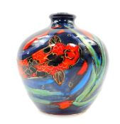 An Anita Harris art pottery vase decorated in the Thal pattern, painted with carp against a blue