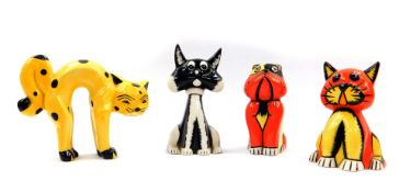 A pair of Lorna Bailey pottery seated cat and dog figures, in red and yellow, printed and painted