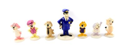 A set of seven Beswick pottery Top Cat figures, comprising Officer Dibble, Top Cat, Benny, Fancy