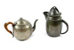 A Liberty & Co Tudric pewter jug, with a hinged lid, No 0232, impressed marks, 18.5cm high.,