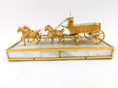 A French Palais Royale type ormolu and mother of pearl model of a cart, being drawn by four