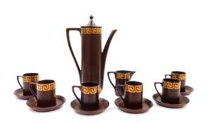 A Portmeirion part coffee service decorated in the Greek Key pattern, against a brown ground,