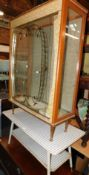 A 1960's glazed and gilt decorated china cabinet, 107cm high, 75cm wide, 30cm deep, together with