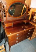 An Edwardian mahogany dressing chest, with oval swing frame mirror above two over two drawers, 150cm