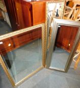 Three wall mirrors, comprising two gilt framed mirrors and a silver framed mirror, 123cm x 35cm,