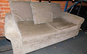 A grey two seater sofa bed.