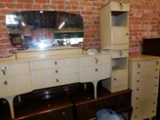 A mid 20thC cream painted part bedroom suite, comprising dressing table, 127cm high, 154cm wide,
