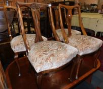 A Harlequin set of four early 20thC walnut dining chairs, raised on cabriole legs. (2 pairs)
