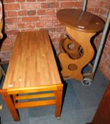 A teak coffee table with laminate top, 42cm high, 94cm wide, 40cm deep, together with an Ercol style