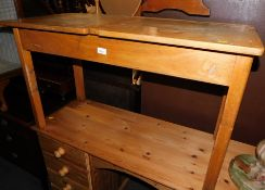 A mid 20thC twin school desk, with two lift lid compartments, 61cm high, 102cm wide, 47cm deep.