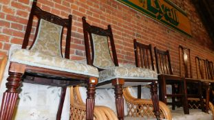 A pair of Victorian hall chairs, upholstered in a green fabric, together with three Queen Anne style