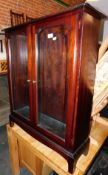 A Stag glazed display cabinet, enclosing two adjustable glass shelves, 100cm high, 81cm wide, 28cm