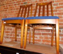 A pair of late 20thC beech framed dining chairs, with blue seats. The upholstery in this lot does