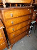 A walnut veneered chest of five graduated drawers, raised on cabriole legs, 107cm high, 78cm wide,