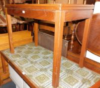 A teak games table, stamped verso AC (Military mark) 1975, raised on square legs, 71cm high, 92cm