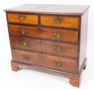 An 18thC oak chest, of two short and three long graduated cock beaded drawers, each with swan neck p