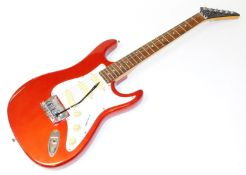 An Encore Coaster six string electric guitar, in red and white trim, 100cm wide.