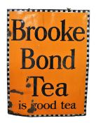 An early 20thC enamel sign, Brooke Bond Tea Is Good Tea, in orange and black colourway, 103cm x 83cm