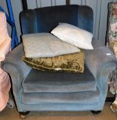 A late Victorian wing style armchair of turned front legs in later blue material, 95cm wide.