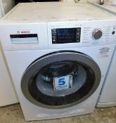 A Bosch Wash & Dry 7/4 series 6 washing machine, 86cm high, 61cm wide, 59cm deep.