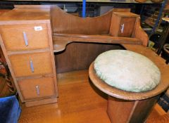 An unusual oak mirror back dressing table with fixed circular stool seat and three drawers, 70cm hig