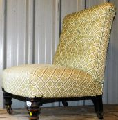 A Victorian ebonised nursing chair, with later checked material and button back, on turned front leg