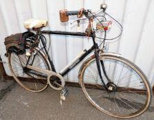 A Centurion vintage gentleman's mountain bike with three speeds, 106cm high.