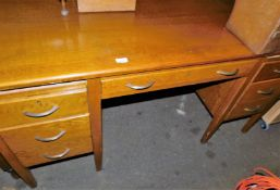 A 1920s oak desk, 75cm high, 150cm wide, 97cm, deep.