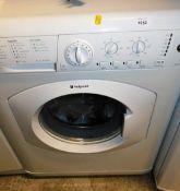 A Hotpoint Aquarius 6kg WML520 washing machine, 85cm high, 61cm wide, 55cm deep.