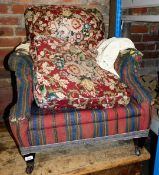 A late Victorian armchair, with upholstered back and seat in later stripe material with a Howard sty