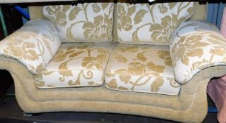 A two seater settee in floral pattern material, 168cm wide.