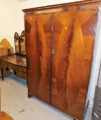 A matched two piece bedroom suite, comprising two door wardrobe with oval flame mahogany style panel