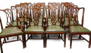 *A set of sixteen mahogany dining chairs in George III style, each with a pierced splat and a green