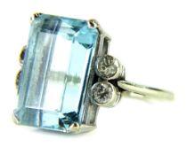 A 9ct white gold aquamarine and diamond dress ring, set with central rectangular cut aquamarine,