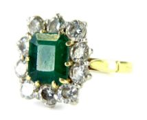 An 18ct gold emerald and diamond dress ring, with central octagon cut emerald, 8mm x 7mm x 4.2mm,