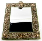 A rectangular silver coloured metal mounted dressing mirror, possibly American, decorated overall