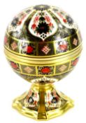 A Royal Crown Derby porcelain Millennium globe clock, with gilt motto to interior There is a