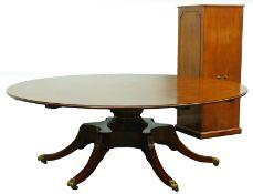 A high quality mahogany 'Jupe' style extending dining table in Regency manner