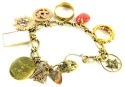 A 9ct gold charm bracelet and ten charms, the modern twist and cross design bracelet, with ten