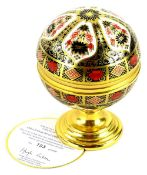 A Royal Crown Derby Imari porcelain Millennium globe barometer, the hinged lid with the motto, He