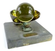 A late 19th/early 20thC Campbell Stokes sunshine recorder, with glass ball and bronzed metal
