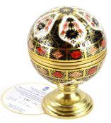 A Royal Crown Derby porcelain Millennium globe thermometer, the hinged lid decorated with the motto,