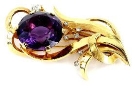 An amethyst and diamond spray brooch, set with single large amethyst 25mm x 15mm, in six claw