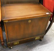 *A stained 20thC campaign style cabinet of rectangular form, with side carrying handles, flush front