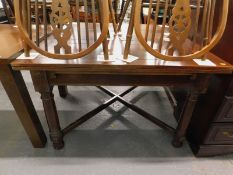 A mahogany extending dining table, on 'X' shaped stretcher.
