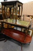 A nest of three tables, each with tooled leatherette tops, a further coffee table and a